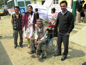 SDM Yuksom(avinash rai) with a disabled person